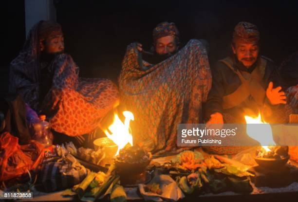 Tenggerese shaman praying for worshippers at Widodaren cave during the Tenggerese Hindu Yadnya Kasada festival in Probolinggo East Java Indonesia on...