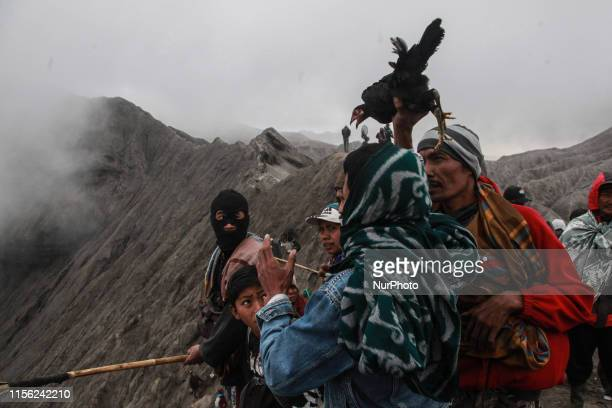 Tenggerese thrown a chicken for sacrifise to the craoter of Mount Bromo during the ceremony of Yadnya Kasada Festival at Probolinggo, East Java, on...