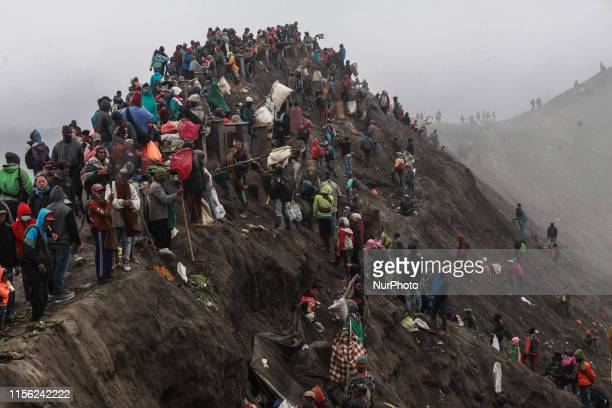 Tenggerese, villagers, and tourists gather at the top of Mount Bromo during the ceremony of Yadnya Kasada Festival at Probolinggo, East Java, on 18th...