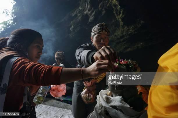 Tenggerese worshipper offer prayer at Widodaren cave during the Tenggerese Hindu Yadnya Kasada festival in Probolinggo East Java Indonesia Yadnya...