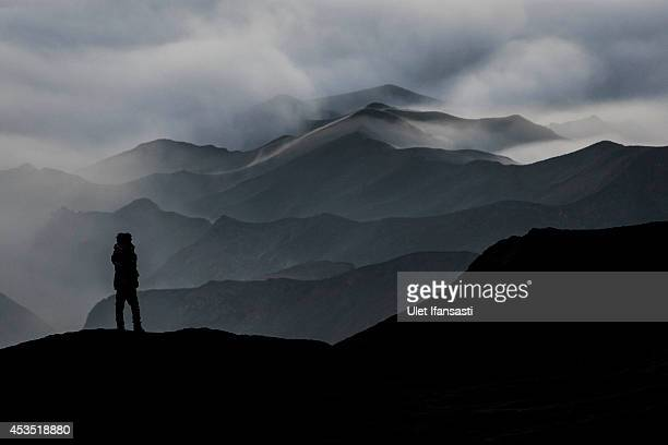 Tenggerese worshipper stands at Mount Bromo's 'Sea of Sand' during the Yadnya Kasada Festival on August 12 2014 in Probolinggo East Java Indonesia...