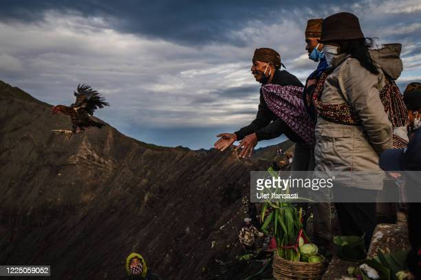 Tenggerese worshipper throw a chicken as offerings during the Yadnya Kasada Festival at crater of Mount Bromo amid the coronavirus pandemic on July...