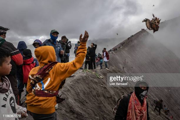 Tenggerese worshipper throw a chicken offerings during the Yadnya Kasada Festival at crater of Mount Bromo on July 18 2019 in Probolinggo Java...