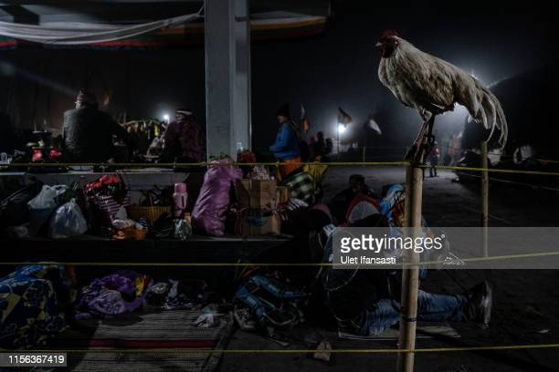 Tenggerese worshippers at Poten temple during the Yadnya Kasada Festival at crater of Mount Bromo on July 18 2019 in Probolinggo Java Indonesia...