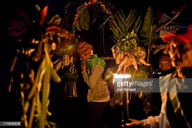 Tenggerese worshippers carry vegetables for an offering during the Yadnya Kasada Festival at crater of Mount Bromo on July 24 2013 in Probolinggo...
