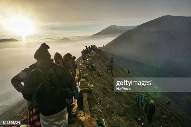 Tenggerese worshippers gather to give their offerings during the Yadnya Kasada Festival at crater of Mount Bromo in Probolinggo East Java Indonesia...