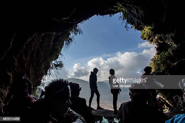 Tenggerese worshippers is seen inside the Widodaren cave as they collect holy water during the Tenggerese Hindu Yadnya Kasada festival on July 31,...