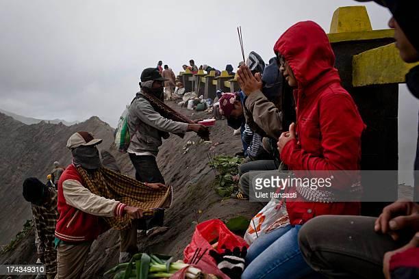 Tenggerese worshippers prays to ancestors during the Yadnya Kasada Festival at crater of Mount Bromo on July 24 2013 in Probolinggo East Java...