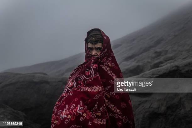 Tenggerese worshippers stands during the Yadnya Kasada Festival at crater of Mount Bromo on July 18 2019 in Probolinggo Java Indonesia Tenggerese...