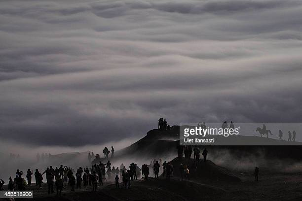 Tenggerese worshippers trek across the 'Sea of Sand' to give their offerings to Mount Bromo during the Yadnya Kasada Festival at crater of Mount...