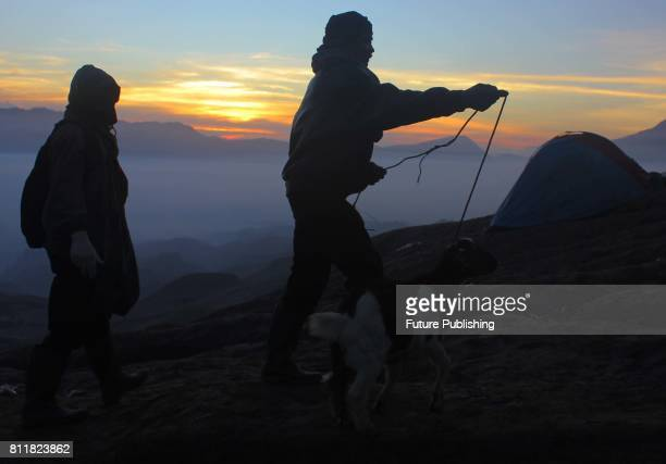 Tenggerese worshippers use their nets to catch offerings thrown into the crater of Mount Bromo by Hindu devotees during the Yadnya Kasada Festival at...