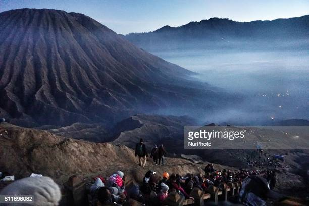 Tenggerese worshippers walk climb the mountain to give their offerings during the Yadnya Kasada Festival at crater of Mount Bromo in Probolinggo East...