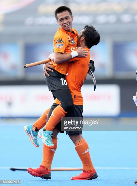 Tengku Ahmad of Malaysia and Faiz Jali of Malaysia celebrate after the quarter final match between India and Malaysia on day seven of the Hero Hockey...
