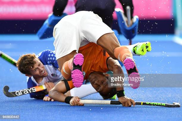 Tengku Tajuddin of Malaysia takes a tumble in the match between Malaysia and Scotland during Hockey on day nine of the Gold Coast 2018 Commonwealth...