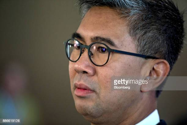 Tengku Zafrul Abdul Aziz chief executive officer of CIMB Group Holdings Bhd listens during a Bloomberg Television interview during the Bloomberg Year...