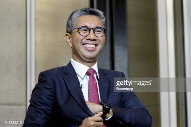 Tengku Zafrul Abdul Aziz chief executive officer of CIMB Group Holdings Bhd reacts during a Bloomberg Television interview at the New Dawn Investors'...