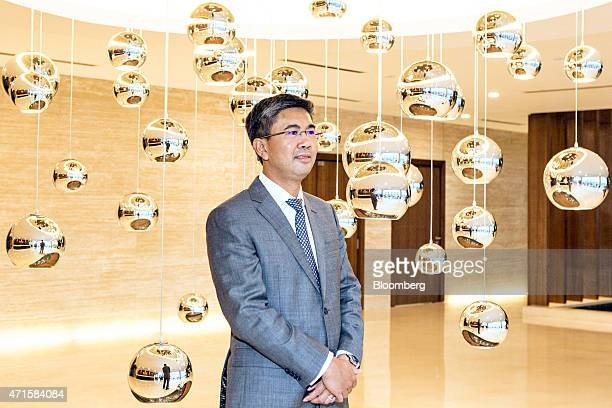 Tengku Zafrul Aziz chief executive officer of CIMB Group Holdings Bhd poses for a portrait before an interview in Kuala Lumpur Malaysia on Wednesday...