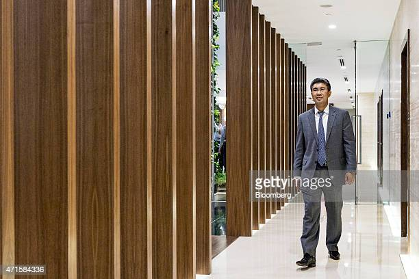 Tengku Zafrul Aziz chief executive officer of CIMB Group Holdings Bhd arrives for an interview in Kuala Lumpur Malaysia on Wednesday April 29 2015...