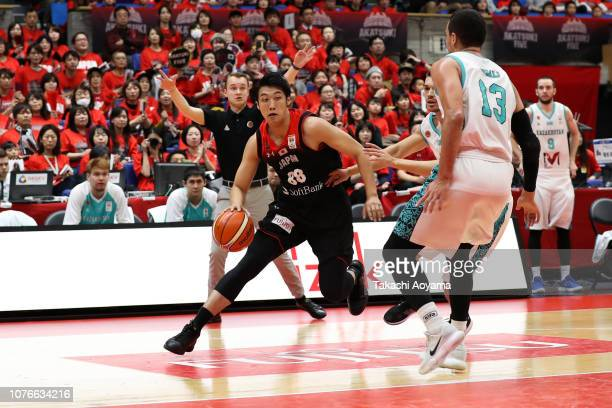 Tenketsu Harimoto of Japan drives to the basket during the FIBA World Cup Asian Qualifier Group F match between Japan and Kazakhstan at Toyama City...