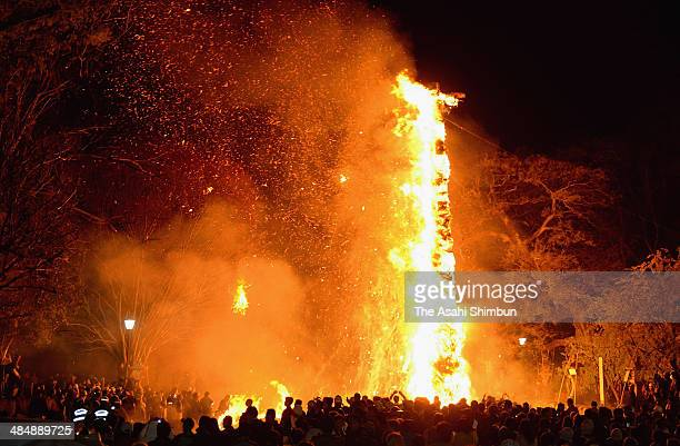 A tenmeterlong giant torches are lit during the 'Taimatsu Festival' as a part of the Hachiman Festival at Himure Shrine on April 14 2014 in...