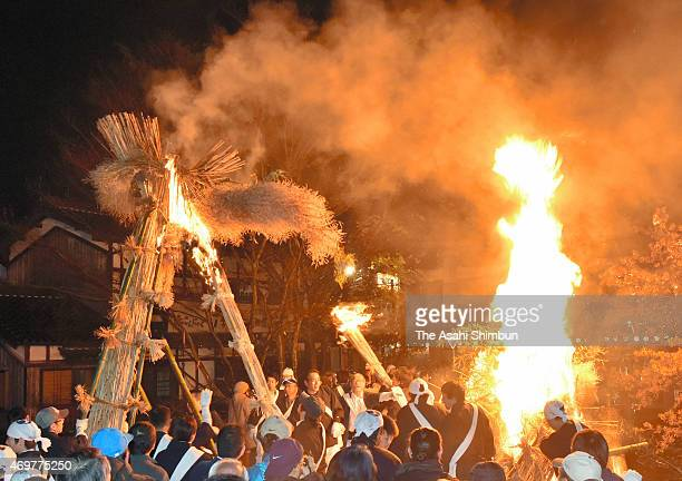 Tenmetertall giant torches are lit during the 'Taimatsu Festival' as a part of the Hachiman Festival at Himure hachimangu Shrine on April 14 2015 in...