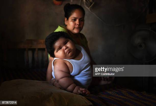 Tenmonthold Luis Gonzales and his mother Isabel Pantoja are pictured at their home in Tecoman Colima state Mexico on November 8 2017 Luis Manuel...