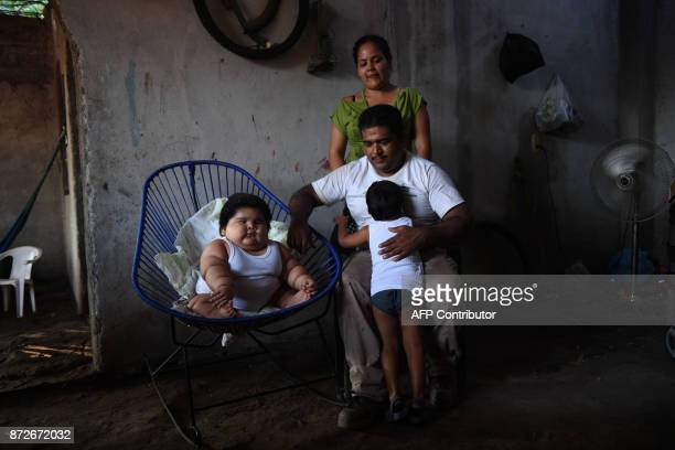 Tenmonthold Luis Gonzales is pictured with his parents Isabel Pantoja and Mario Gonzales and his elder brother Mario at their home in Tecoman Colima...
