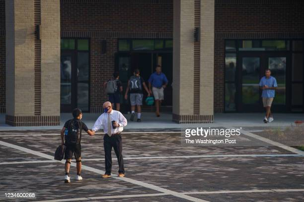 Tenn. - Aug. 9, 2021: Brentwood High School Principal, Kevin Keidel, greets students as they make their way in as the new school year begins.