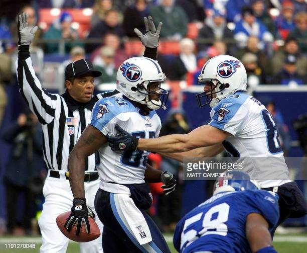 Tennesse Titans' wide receivers Derrick Mason and Drew Bennett celebrate Mason's second quarter touchdown reception against the New York Giants 01...