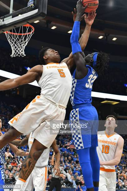 Tennessee forward Admiral Schofield reaches in two block a shot by Kentucky forward Wenyen Gabriel during a Southeastern Conference Basketball...