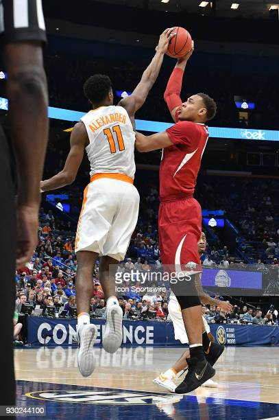 Tennessee forward Kyle Alexander blocks a shot by Arkansas guard Anton Beard during a Southeastern Conference Basketball Tournament game between the...