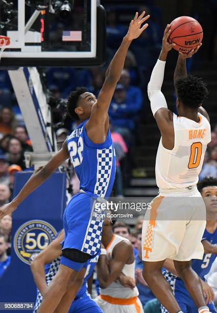 Tennessee guard Jordan Bone shoots over Kentucky guard Shal GilgeousAlexander during a Southeastern Conference Basketball Tournament game between the...