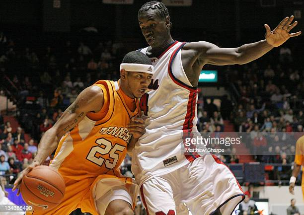 Tennessee guard Josh Tabb goes around Ole Miss forward Eneil Polynice at the Tad Smith Coliseum in Oxford, Mississippi on January 24, 2007. Ole Miss...
