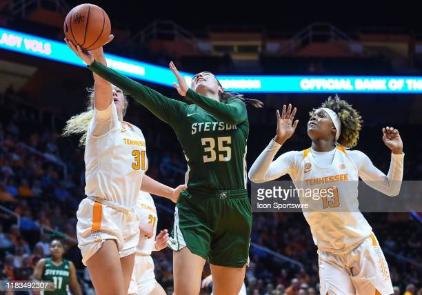 Tennessee Lady Vols center Emily Saunders blocks the shot of Stetson Hatters forward Kendall Lentz during a college basketball game between the...