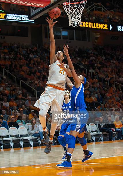 Tennessee Lady Volunteers center Mercedes Russell drives past Kentucky Wildcats center Alyssa Rice for a lay up during a game between the Tennessee...