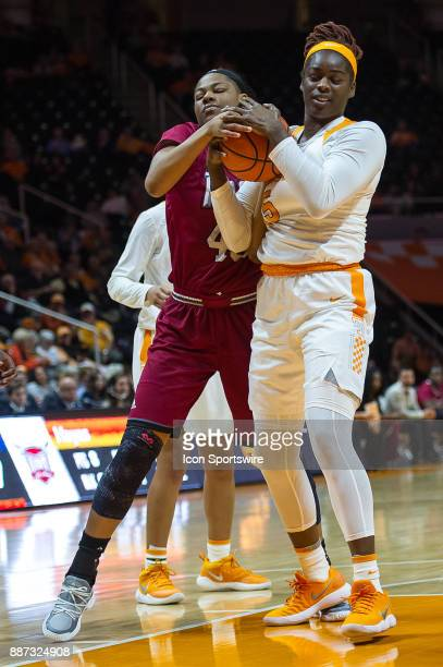Tennessee Lady Volunteers forward Cheridene Green and Troy Trojans forward Amber Rivers fight for the ball during a game between the Troy Trojans and...