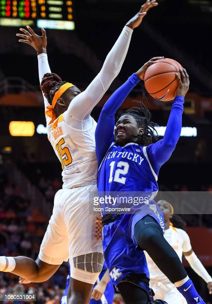 Tennessee Lady Volunteers forward Cheridene Green tries to block the shot of Kentucky Wildcats guard Amanda Paschal during a game between the...
