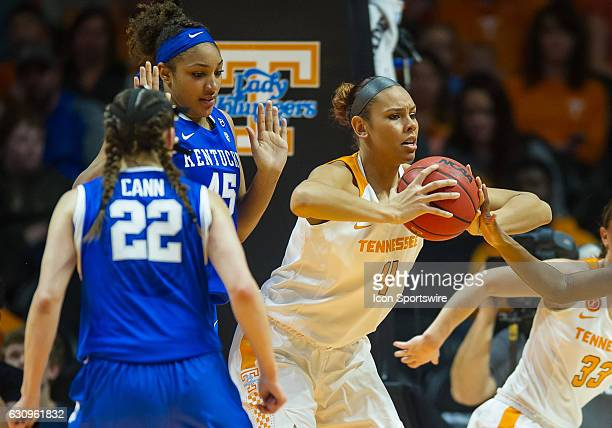 Tennessee Lady Volunteers forward/center Schaquilla Nunn grabs a rebound and fights for position on Kentucky Wildcats center Alyssa Rice during a...