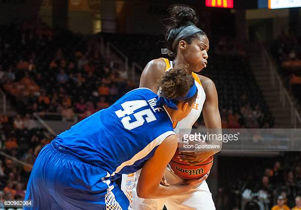 Tennessee Lady Volunteers guard Jordan Reynolds and Kentucky Wildcats center Alyssa Rice fight for a rebound during a game between the Tennessee Lady...