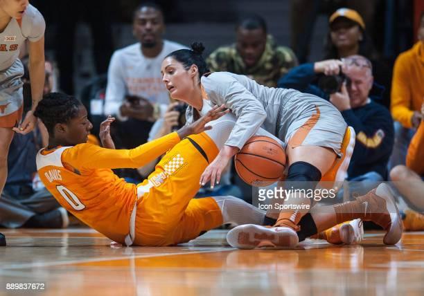Tennessee Lady Volunteers guard/forward Rennia Davis and Texas Longhorns forward AudreyAnn CaronGoudreau scramble for a loose ball during a game...