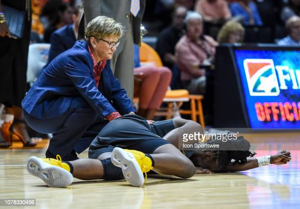Tennessee Lady Volunteers head coach Holly Warlick comforts an injured Missouri Tigers guard Amber Smith during a college basketball game between the...