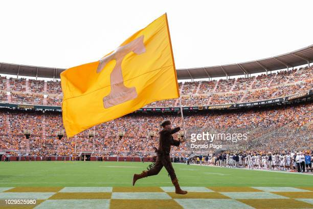 Tennessee mascot Davy Crockett carries the flag across the end zone during a game between the Tennessee Volunteers and the East Tennessee State...