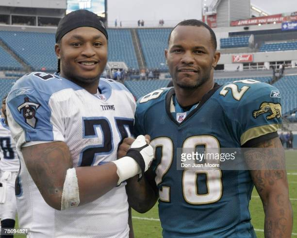 Tennessee RB LenDale White left poses with Jacksonville RB Fred Taylor right on November 5 2006 in Jacksonville Florida The Jaguars defeated the...