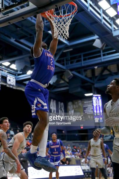 Tennessee State Tigers forward Emmanuel Egbuta scores with a dunk during the first half of the college basketball game between the Tennessee State...
