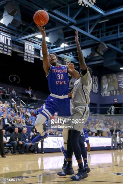 Tennessee State Tigers forward Stokley Chaffee Jr shoots as Akron Zips center Deng Riak defends during the first half of the college basketball game...