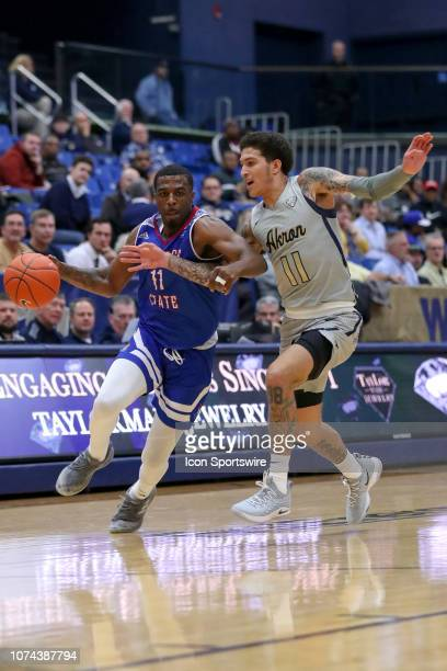 Tennessee State Tigers guard Kamar McKnight is defended by Akron Zips guard Channel Banks as he drives to the basket during the first half of the...