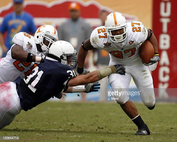 Tennessee tailback Arian Foster looks to break the tackle of Penn State's Paul Posluszny during Monday's Outback Bowl Game at Raymond James Stadium...