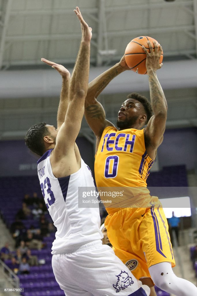 Tennessee Tech Golden Eagles guard Shaq Calhoun (0) drives to the basket with TCU Horned Frogs forward Ahmed Hamdy-Mohamed (23) defending during the game between the Tennessee Tech Golden Eagles and TCU Horned Frogs on November 13, 2017 at Ed & Rae Schollmaier Arena in Fort Worth, TX.