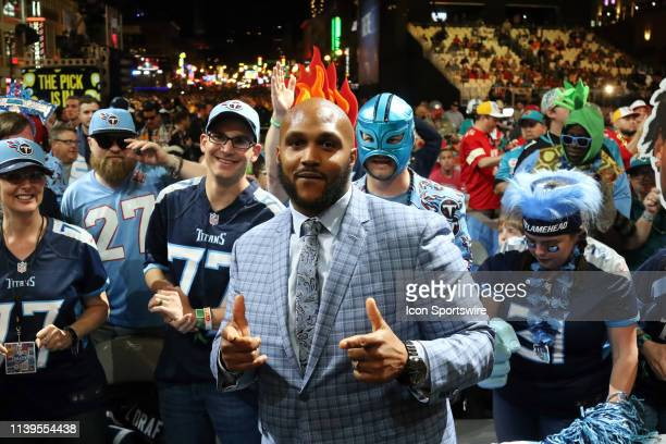 Tennessee Titan defensive end Jurrell Casey poses with fans during the second round of the 2019 NFL Draft on April 26 at the Draft Main Stage on...