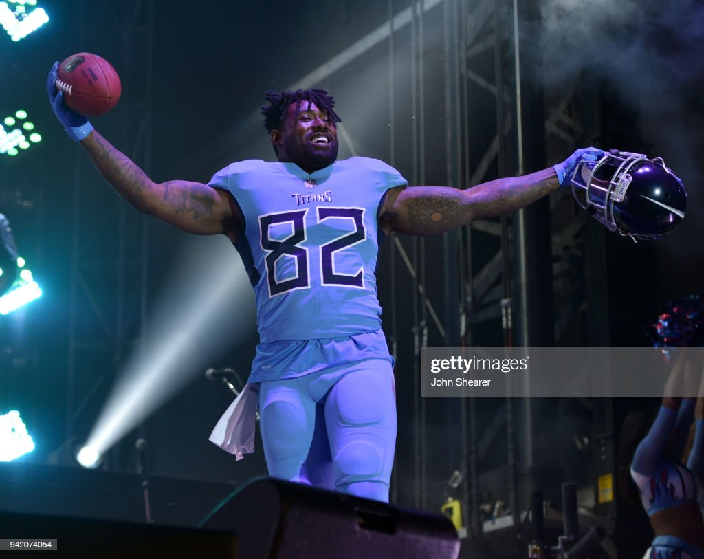 Tennessee Titan, Delanie Walker, shows off new uniform during The NFL's Tennessee Titans team up for the 'Tradition Evolved' concert event in downtown Nashville to celebrate The Titans new 2018 uniforms on April 4, 2018 in Nashville, Tennessee.